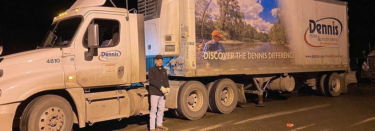 man in front of tractor trailer