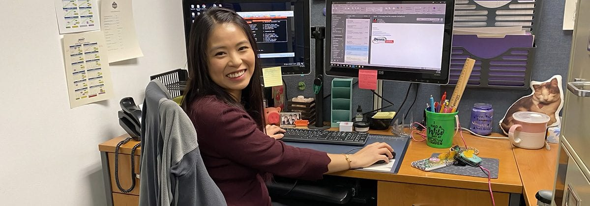 Amy Yuen working at desk