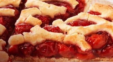 sliced cherry pie with lattice crust
