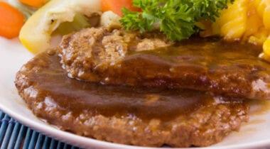 salisbury steak with brown gravy and vegetables