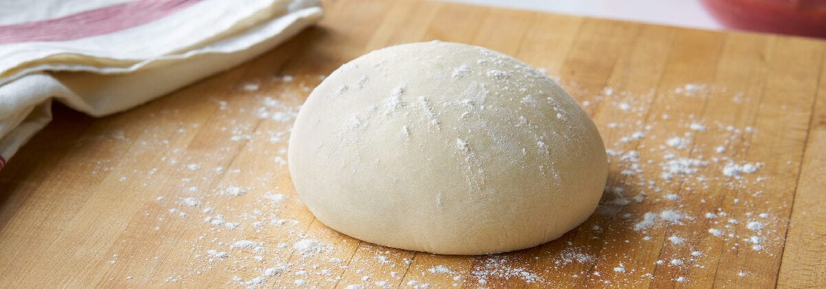 pizza dough ball with flour