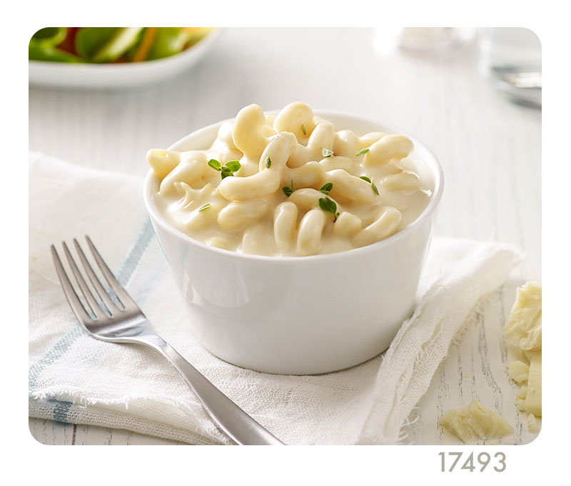 white cheddar mac and cheese, white bowl, fork, napkin