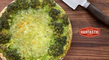 broccoli quiche on cutting board with knife