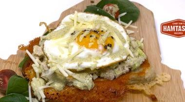 sunny side egg open face sandwich on cutting board