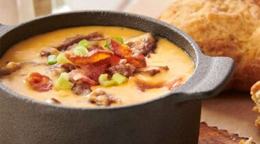 cheese spread dip topped with bacon and scallions