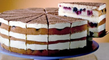Tiramisu Moscato Berry Cake with sliced lifted out