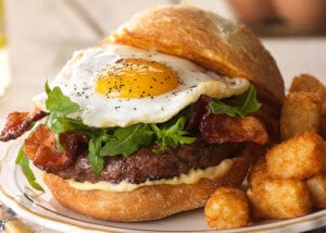 bacon burger with egg. Over easy burger with tater tots