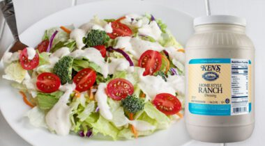 Homestyle ranch dressing jug next to a plate of salad
