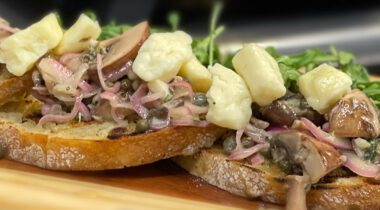 mushrooms, onions, and cheese curds on bread