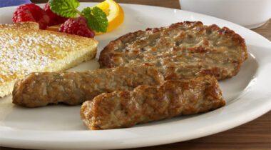 sausage patty and links on plate
